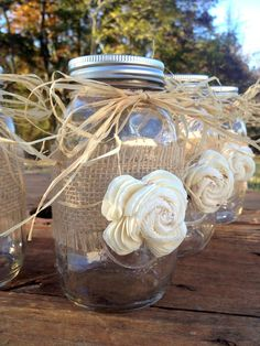 This listing includes (1) Quart size, 32 oz, American Ball Mason Jars. Mason jars are wrapped with burlap and have a beautiful sola flower attached in the middle and the top is tied with raffia. These