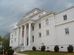In 1777 Wilkes county was created from Surry and Burke Counties. Its first courthouse was built of logs at Mulberry Fields, (now Wilkesboro), the county seat. The county court ordered the building removed Wilkes County Courthouse from its site in 1830 and it was used as a stable until 1900. The second courthouse was constructed on the old site and it served until it was replaced by the present one in 1902.