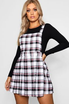 7a55d3053658 Click here to find out about the Plus Checked Pinafore Dress from Boohoo,  part of
