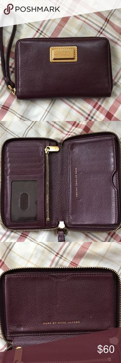 PRICE DROP- Marc Jacobs Leather Wristlet Marc by Marc Jacobs Q Wingman Small Leather Wristlet. Maroon color. Holds iPhone 6. Great condition. Marc By Marc Jacobs Bags Clutches & Wristlets