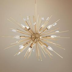 A plated antique gold finish sputnik style pendant chandelier light with clear crystal.