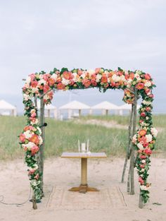 A seriously beautiful floral covered ceremony: http://www.stylemepretty.com/2015/01/14/elegant-cape-cod-wedding/ | Photography: Lisa Rigby - http://www.lisarigbyphotography.com/