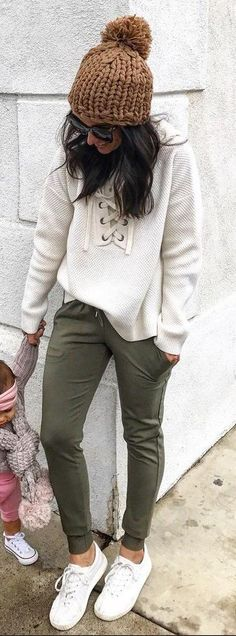 Brown Beanie / White Knit / Green Skinny Pants / White Sneakers