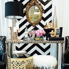 This chevron wallcovering with the gold vintage mirror and glamorous accessories really creates a chic focal point!