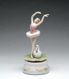 Cosmos SC49153 Fine Porcelain Ballerina with Swan Musical Figurine, 7-3/8-Inch