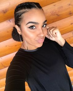 I have been bangin' out some BOMB protective styles lately! Rocked some cornrows + large bun (added braiding hair) this past weekend while on a cabin trip with my sorority sisters and it was awesome! Didn't have to touch my hair for 3 days! Yasssssssssss.