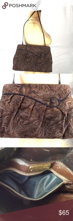 """vintage Stuart Weitzman purse suede leather swirls vintage Stuart Weitzman Spanish suede leather brown with swirl pattern handbag purse medium size, convertible clutch, shoulder, cross body both sides: braided swirled black rope detail metal side hinged opening inter metal top snap closure leather interior / 1 compartment / 1 interior zip pocket long thin leather strap tucks inside for clutch good vintage condition gently/rarely worn some age appropriate wear Approx measurements: 8 3/4"""" d x…"""
