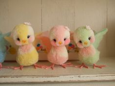 Adorable birdies...they look like they're made out of pom poms.