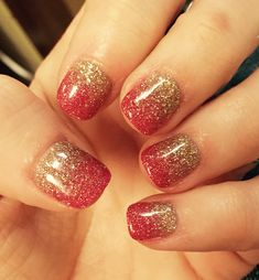 Red nails with spread gold glitter touches