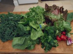 May 14, 2014: kale, spinach, escarole, red butter lettuce, parsley, radishes, spring onions. Escarole is good in salad, but I prefer to cook it like spinach or dandelion greens. Usually I'll chop half the parsley and dry the other half in the oven, but this week I went for pesto.