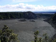 Looking across the Kilauea Iki crater to the Puu Puai cinder cone. Note the bathtub rings marking high levels of the lava lake before it drained for the last time.