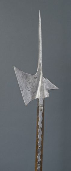 Halberd  Artist/maker unknown, Swiss  Geography: Made in Switzerland, Europe Date: c. 1530-1550 Medium: Engraved steel (Head); wood, replaced (Shaft) Dimensions: Head: 8 3/4 x 18 1/4 inches (22.2 x 46.4 cm) Curatorial Department: European Decorative Arts and Sculpture * Gallery 247, Arms and Armor, second floor (Kretzschmar von Kienbusch Galleries)  Accession Number: 1977-167-337 Credit Line: Bequest of Carl Otto Kretzschmar von Kienbusch, 1977