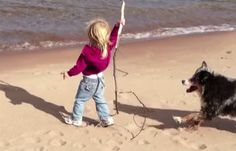She's Getting Ready To Throw A Stick Into The Ocean. Now Watch The Dog.