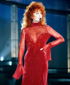 Reba McEntire in the famous red dress at the 1993 CMA Awards. I will never forget when this dress made history! Now it is in the country music hall of fame.