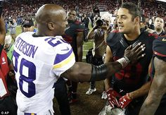 Hayne is congratulated by Minnesota Vikings running back Adrian Peterson (left)