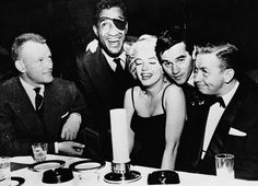 Marylin Monroe with actor Jacques Sernas, Sammy Davis, Jr., photographer Milton H Greene and jazz musician Mel Torme at the Crescendo Club, Los Angeles, California, 1954 | StyleCaster