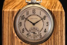 Restored American Pocket Watches Turned Desk Clocks  http://www.analogshift.com/products/hamilton-deco-pocket-watch-and-zebra-wood-stand
