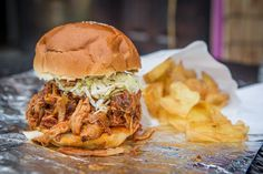 Fancy Pig has replaced the short-lived salad bar next to Romeo's Juice Bar in Kensington Market. Salad Bar, Pulled Pork, Toronto, Sandwiches, Restaurant, Fancy, Treats, Ethnic Recipes, Food