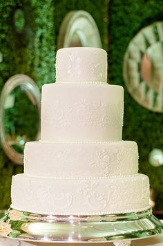 Classic white wedding cake with four tiers of stunning detail.
