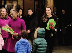 The Duchess of Cambridge receives flowers before leaving the Northside Center in Harlem, December 8th 2014.