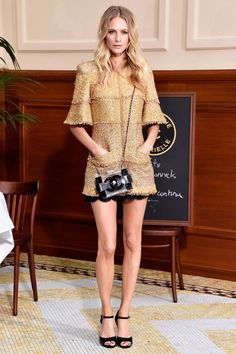 Poppy Delevingne killing it in a metallic tweed minidress at Chanel Fall RTW 2015 {via The Zoe Report}