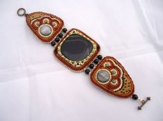 bead embroidered bracelet with large focal stone