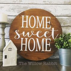 Home sweet home! This farmhouse inspired sign is the perfect greeting as you enter your home every day. Know someone getting married or who recently bought a new home? Why not get this sign as a house warming or wedding gift? This wood round measures approximately 18 in diameter. Then sign is stained in a rich neutral walnut finish with creamy white lettering. A hanging hook is included for easy hanging. Place this sign in your entry way, kitchen, or living room gallery wall...the…