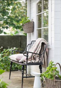 Fresh green farmhouse style porch with pop of black