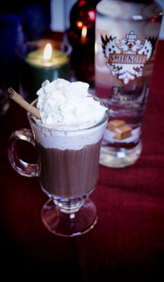 Texan Hot Cocoa drink recipe: 1 oz SMIRNOFF® Kissed Caramel® Flavored Vodka, 5 oz spicy hot cocoa. Heat over medium-high heat. Pour into mug. Garnish with whipped cream and grated cinnamon. #Smirnoff #vodka #hotcocoa #whippedcream #chocolate