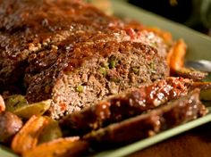 Old-Fashioned Meat Loaf- A.K.A 'Basic' Meat Loaf. verything about this meat loaf was awesome! The glaze on top was superb! I used Dijon mustard in the sauce which gave it a little zing to it. And Paula is so right about using 80/20 ground beef. You really need it for moisture along with the water content in the onions and bellpepper it was very moist. Not dry at all. My grand daughter made sure we saved her some for her lunch for school the next day! And every ones plate was wiped clean :)