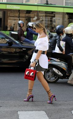 Off-the-shoulder shirting during Milan Fashion Week. (Photo: Lee Oliveira for The New York Times)