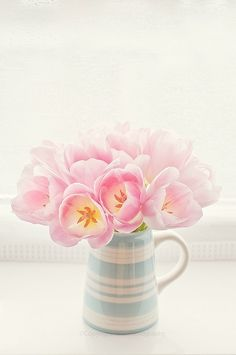 Pink tulips in a light blue & white vase