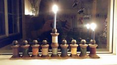 Love this menorah! Antique wooden spools, wool yarn, beads or candle cups, vintage ruler to glue them on. Rustic & charming!