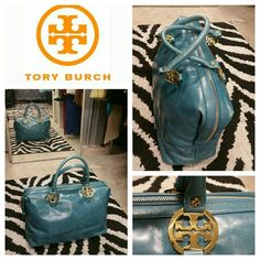 Tory Burch Jaden Satchel The Tory Burch Jaden Satchel in ocean blue is made of glazed leather with gold tone hardware. The tote has two top rolled leather handles ending in designer logo gold medallions. Top zip fastening with press-stud-fastening tabs at each end, an internal zippered pocket and accessory pockets, internal gold Tory medallion and logoed lining. Dust bag. Excellent next to new condition. No visible signs of wear. Tory Burch Bags Satchels