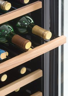 Danby Wine Coolers or wine Fridge. Featuring 6.5 sliding black wire shelves with beechwood face. Great with any home decor. Try Danby's DWC508BLS