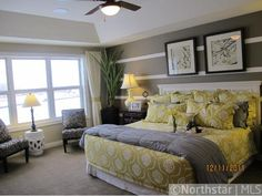 Bedroom with yellow and gray color scheme