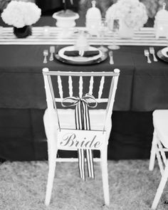 Signs denoting the couple's titles for the day hung from their chairs with black-and-white striped ribbon