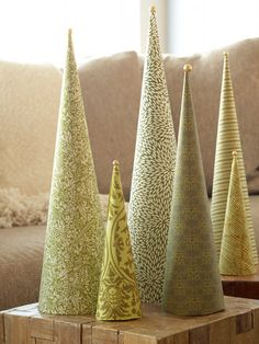 Holiday Forest Display  Create a tabletop forest of pretty Christmas trees. Roll patterned papers in shades of green around plastic foam cones; glue into place. Hot-glue sparkling bead atop each tree.