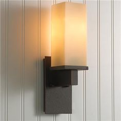 Like the modern lines of this for the toddler's playroom. Also looks good on a paneled wall! Rectangular Craftsman Blackened Iron Wall Light | shadesoflight.com