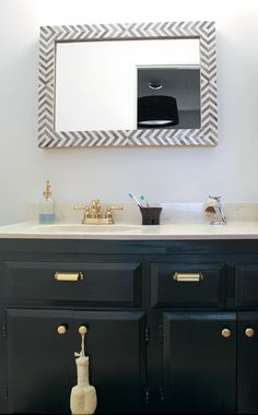 Hey. That looks like my crappy vanity and courntertop. Maybe I need shiny knobs and some decoupage on the mirror frame.