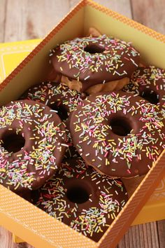 Baked Vegan Donuts topped with melted chocolate and sprinkles! #vegan #lovingitvegan #donuts #dessert