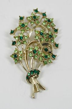 Vintage Green Rhinestone Bouquet Broach Pin r.ebay.com/FReRGN    Each bridesmaid with a grey dress- ribbon/belt in green with green broach pinned near hip. (right side or left side?)