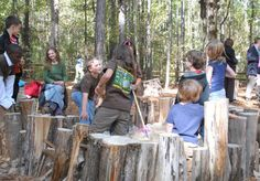 "Fifth-grade students from Cary Woods Elementary play on the Nature Playground at the Louise Kreher Forest Ecology Preserve Nov. 9. The playground is designed to provide fun, naturalistic play spaces with logs, tunnels, trees and unique structures, such as a tree house and an ""eagle's nest"" for kids to explore. (Elaine Busby / Assistant PHOTO EDITOR)"