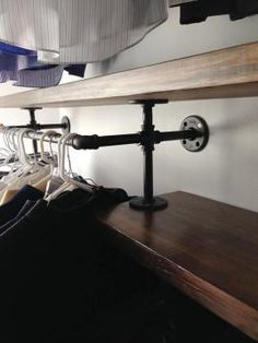 Industrial closet organizer made with steel pipes! Gorgeous.