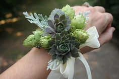 love this to match the button holes, but perhaps spray roses instead of hops flowers, and the succlents a little more stuble and maybe to pin rather than to tie around the wrist