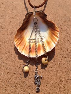 interesting way to hang chain  with charms off a shell