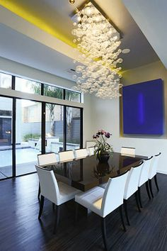 17x14. Handsome formal dining room features custom Prospetto glass bubble chandelier, lighted art niche and hardwood plank flooring. A perfect atmosphere for entertaining.