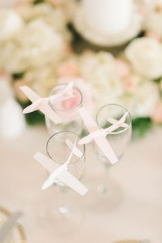Travel or airplane-themed wedding idea - paper airplanes to embellish champagne glasses! {Elizabeth Fogarty}