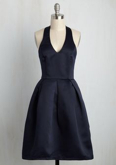 Mark tonight as a truly unforgettable occasion by wearing this deep navy blue dress for dancing and dinner. As the satiny A-line silhouette makes its daring debut, the plunging halter neckline and pleated skirt that define this ModCloth-exclusive stunner earn you eyes of admiration.