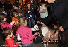 Scout enjoying himself meeting children.
